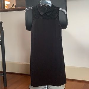 Black collared dress with gold embellishment